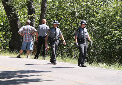 (Editors note: run small) State Police investigate a fatal motorcycle crash on Euclid Road Saturday. Seb Foltz/Butler Eagle