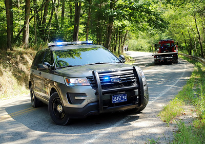 State police set up a road block at a bend on Euclid Road (pictured) near  Dingle Road, the site of a fatal motorcycle accident Saturday. Seb Foltz/Butler Eagle