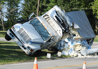 Harold Aughton/Butler Eagle: A truck carrying ice crashed into a utiltiy pole spilling its load at the intersection of Route 8 and Dinnerbell roads. Route 8 was closed in both directionrs for several hours. No injuries were reported.