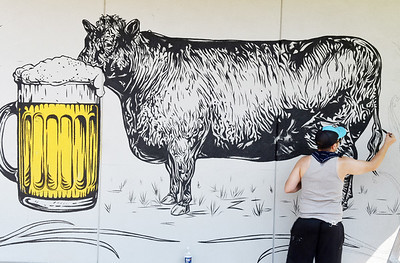 Harold Aughton/Butler Eagle: Phil Seth, a 2001 seneca valley grad, finishes the tail end of his mural at BURGH'ers Brewing in Zelienople Saturday, July 4, 2020.