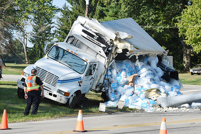 Harold Aughton/Butler Eagle: A truck carrying ice crashed into a utiltiy pole spilling its load at the intersection of Route 8 and Dinnerbell roads. No injuries were reported.
