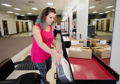 Audra Bowers of Encore Studio by Audra Jane preps stations during renovations at her salon. Bowers, a former JC Penny's sylist bought the former salons equipment and hired it's laid off staff to open her own salon in Moraine Point Plaza. Seb Foltz/Butler Eagle