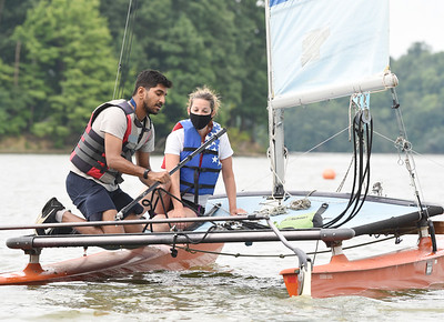 Harold Aughton/Butler Eagle: Tanmay Shankar of India and Bethany Salvatore of Wexford launch a catamaran during the Moraine Sailing Club learn how to sail Saturday, August 15, 2020.