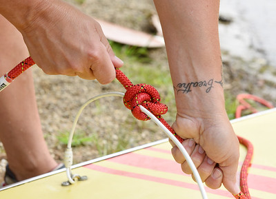 Harold Aughton/Butler Eagle: Kerry Baur of Cranberry Twp. ties a bowlen knot during the Moraine Sailing Clubs learn how to sail event Saturday, August15, 2020.