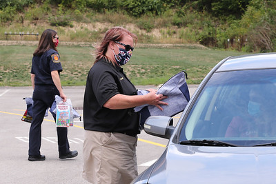 Cranberry police administrator Lori Lowry and members of the Cranberry Township Community Response Team hand out bags of school supplies Thursday at the townthip's public works facility. Seb Foltz/Butler Eagle Aug. 27 Thurs