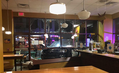 General byline: A police vehicle crashed into Butler Penne in Butler  late Wednesday night. The officer was responding to another vehicle accident on Center Avenue when it occurred. The cause of the accident was reportedly another vehicle running a red light and the officer attempting to avoid he crash according to Bill Atkinson owner of Butler Penne. Pictured in the one photo is Joe Gray and his wife Jackie who own the building, inspecting the damage from the accident.