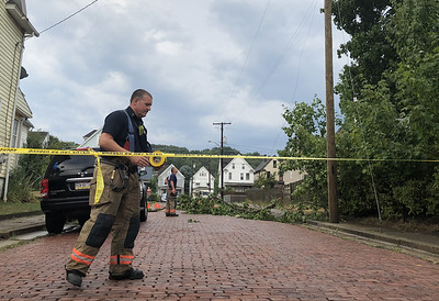 A thunderstorm roared through the county Thursdayevening leaving behind downed lines and trees along with power outage.Fire crews responded to a downed power line on Beckert Avenue.According to a group of children eyewitnesses at the scene the tree broke the wire and the transformer located at the intersection of Virginia Avenue and Beckert Avenue. 8/27/2020 looFire crews closed down the road while they dealt with the downed wires.
