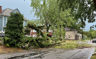 A thunderstorm roared through the county Thursday evening leaving behind downed lines and trees along with power outages.Pictured is a downed tree, cable and power line on the 400 block of North McKean Street.The National WeatherService of Pittsburgh issued a severe thunderstorm warning. Photographs special to the Eagle by Nate Black