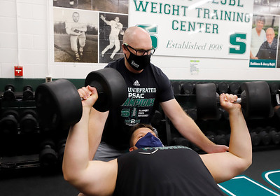Slippery Rock  redshirt freshman and Butler class of 2019 alum Samuel Enslen gets a spot from head football athletic trainer Brad Shaeffer Scott Morrison. Seb Foltz/Butler Eagle Aug. 2020
