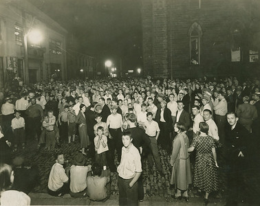 "Crowd in stree in front of Eagle Building to hear nomination results on the night of September 15, 1931. Results were given by John Gerald & Vernon Wise over a ""Public Speaker"" contrivance. – Bertha L. Wise   Eagle File Photo."