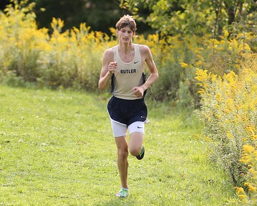 Butler junior C.J. Singleton holds a sizable lead down the final stretch in the boys varsity cross country meet Tuesday's  at Butler. Singleton held on to win. Seb Foltz/Butler Eagle 09/15/20