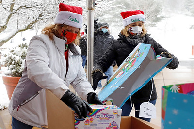 Kari Biehl and Christine DeHart of MSA Safety Inc. in Cranberry deliver toys dropped off at their Best of the Batch Foundation toy drive collection Tuesday. Former Steeler Charlie Batch was on site to help collect toys for his foundation. Seb Foltz/Butler Eagle 12/01/20