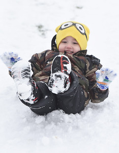 Roman Bechtel, 4, of Butler enjoyed sled riding with his brother, Jacob Hillard, 14 and sister Lily Hillard, 16, in Father Marinaro Park along Short Street in Butler Tuesday afternoon, December 1, 2020.  Harold Aughton/Butler Eagle.