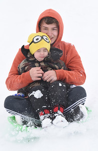 Jacob Hillard, 14, of Butler hangs onto his brother, Roman Bechtel, 4, while sled ridding in Father Marinaro Park along Short Street in Butler Tuesday afternoon, December 1, 2020.  Harold Aughton/Butler Eagle.