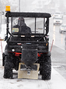 Mike Christy of Butler County Ford salts the sidewalks along S. Main Street in Butler Tuesday morning, December 1, 2020. Harold Aughton/Butler Eagle