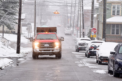 A crew from the Butler Public Works Department speads salt along North Monroe Street in Butler Tuesday morning, December 1, 2020.  Harold Aughton/Butler Eagle.