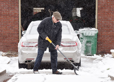 Ken Thomas of Belmont Avenue in Butler shovels his driveway Tuesday morning, December 1, 2020.  Harold Aughton/Butler Eagle.