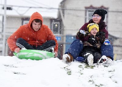 Jacob Hillard, 14, and his sister Lily Hillard,16, both students in the Butler School District took their lunch break from cyber school to sled ride with their 4-year-old brother, Roman in Father Marinaro Park along Short Street in Butler Tuesday afternoon, December 1, 2020.