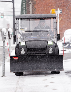 Mike Christy of Butler County Ford salts the sidewalks along E. Wayne Street in Butler Tuesday morning, December 1, 2020. Harold Aughton/Butler Eagle