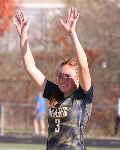 Mars' Ellie Coffield waves to the crowd at WPIAL Championship ceremonies following the teams 1-0 win over Plum. Seb Foltz/Butler Eagle 11/7/20