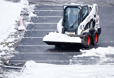 Work crews from Kenmac Rentals in Butler remove snow after the Butler Health System COVID testing center's tent collapsed following Tuesday's snow storm Wednesday, December 2, 2020. Harold Aughton/Butler Eagle