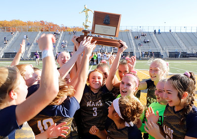 Mars' Ellie Coffield raises the in WPIAL championship at trophy at North Allegheny. Mars topped Plum 1-0 to earn back-to-back titles. Seb Foltz/Butler Eagle 11/7/20