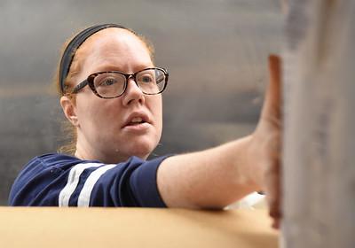 Erin Makowski, director of the Southwest Butler Food Cupboard, stocks shelves with pancake flour Wednesday, December 2, 2020. Harold Aughton/Butler Eagle.