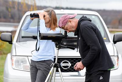 Retirees Mark and Faith Loretto of Harmony focus their spotting scope and binoculors on a Whistling Swan or Thundra Swan at Lake Arthur Wednesday, Nov. 11, 2020. Harold Aughton/Butler Eagle