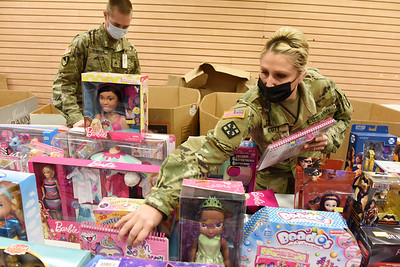 Katie Scott and Justin Stivason of the 377th Engineer Company of the US Army Reserves of Butler volunteered to unpack, sort and categorize toys at the U.S. Marine Corp Toys for Tots toy drive at the Clearview Mall Monday, December 7, 2020.  Harold Aughton/Butler Eagle.