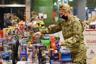 Katie Scott of the 377th Engineer Company of the US Army Reserves of Butler volunteered to unpack, sort and categorize toys at the U.S. Marine Corp Toys for Tots toy drive at the Clearview Mall Monday, December 7, 2020.  Harold Aughton/Butler Eagle.