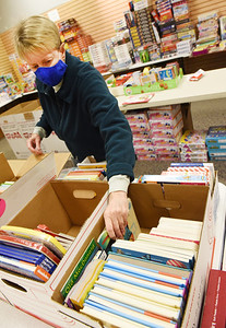 Kathy Enright of Butler volunteered to help unpack, sort and categorize books, crafts and toys at the Toys for Tots toy drive at the Clearview Mall Monday, December 7, 2020. Harold Aughton/Butler Eagle.