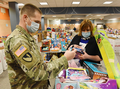 Justin Stivason of the 377th Engineer Company of the US Army Reserves of Butler and Yvonne Smith of Portersville volunteered to unpack, sort and categorize toys at the U.S. Marine Corp Toys for Tots toy drive at the Clearview Mall Monday, December 7, 2020.  Harold Aughton/Butler Eagle.