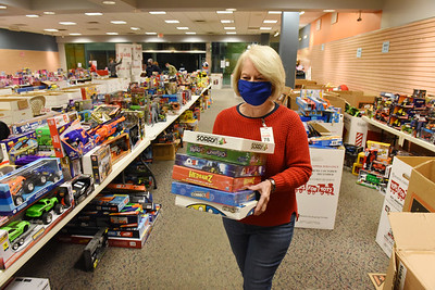 Sue Hamilton of Zelienople volunteered to unpack, sort and categorize toys at the U.S. Marine Corp Toys for Tots toy drive at the Clearview Mall Monday, December 7, 2020.  Harold Aughton/Butler Eagle.