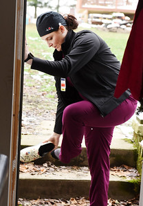 Hannah Osborne of Jefferson Township has been working as a nurse in the COVID unit of the Butler Memorial Hospital since the pandemic started in March. Before entering her home, she takes her shoes off and leaves them outside the house. December 4, 2020.  Harold Aughton/Butler Eagle.