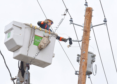 Work crews from Main Lite Electric out of Warren, Ohio install new lines along N. High Street in Zelienople Tuesday, December 8, 2020. Harold Aughton/Butler Eagle.
