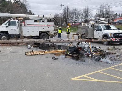 Jim Smith photo. West Penn Power workers respond to a broken utility pole in the parking lot  at the True Value store on Route 356 in Buffalo Township shortly before noon Tuesday. The pole was knocked down when a customer accidentally hit it while backing up in a pickup truck. No one was injured but electrical service was lost for about 30 minutes in most of the township.