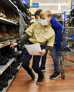 Boy Scout Elijah Adley, 12, of Cabot and Michael Teneyck, 12 of Saxonburg shops for gifts during Troop 58's annual shopping spree for families in need Tuesday, December 9, 2020. Harold Aughton/Butler Eagle.