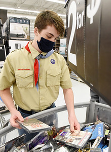 Boy Scout Colton Velesig, 15, of Saxonburg took part in Troop 58's annual shopping spree for families in need Tuesday, December 9, 2020. Harold Aughton/Butler Eagle.