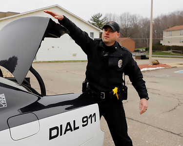 Slippery Rock police officer Derek Dickey loads gear into his cruiser Wednesday. Seb Foltz/Butler Eagle. 12/09/20