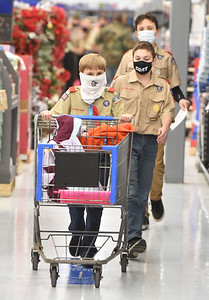 Boy Scouts Tobias Webb, 12, Camden Christie, 12, and Gavin Danehy, 13, of Troop 58 participated in the shopping spree for families in need Tuesday, December 9, 2020. Harold Aughton/Butler Eagle.