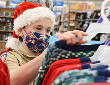 Boy Scout Turner Cox, 11, of Mars shops for gifts during Troop 58's annual shopping spree for families in need Tuesday, December 9, 2020. Harold Aughton/Butler Eagle.