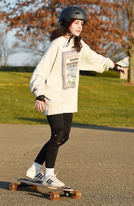 Chloe Ciora, 22, of Nixon Twp, and a senior University of Pittsburgh computer science major, started her winter break skate boarding at the Adams Twp. Community Park, Thursday, December 10, 2020. Harold Aughton/Butler Eagle.