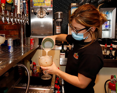 Bartender Amber Wetzel pours a margarita Thursday at Texas Roadhouse in the Clearview Mall shoping center. Seb Foltz/Butler Eagle 12/10/20