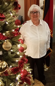 LOCAL PHOTO 12/10 Salvation Army Captain Darlene Means said the Butler Salvation Army's Red Kettle is over halfway to its $80,000 goal. ERIC FREEHLING/BUTLER EAGLE