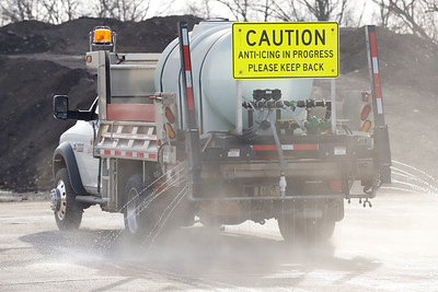 A Cranberry Township de-icing truck leaves the Public Works garage Tuesday prepping roads in advance of Wednesday's forecasted snow storm. Seb Foltz/Butler Eagle