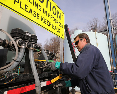 Frank Murcko of Cranberry Township Public Works preps a de-icing truck Tuesday at the township maintenance facility. Seb Foltz/Butler Eagle 12/15/20