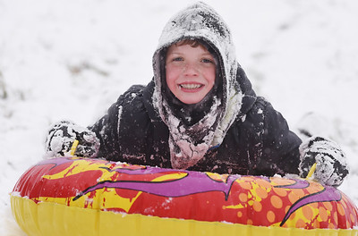Jacob Bridgeman, 11, of Valencia spent the afternoon sled riding with his brother Michael, 14, and dad Jim Bridgeman at Glade Run Lake Wednesday, December 16 2020. Harold Aughton/Butler Eagle.