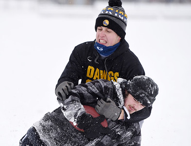 Ty Garver, junior at Mars High School, tackles classmate Matthew Mroz during a pickup game of football Thursday, after school, December 17, 2020. Harold Aughton/Butler Eagle.