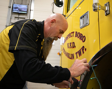 Prospect Boro Fire Department Chief Ken Wilson prepares one of the departments engines for Santa's visit. Seb Foltz/Butler Eagle 12/17/20