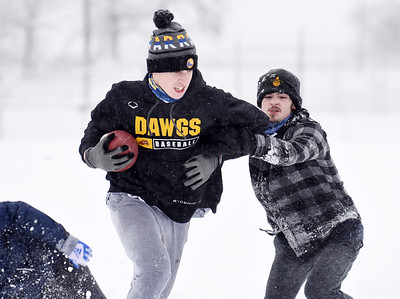 Ty Garver, junior at Mars High School, attempts to make a move on classmate Matthew Mroz during a pickup game of football Thursday, after school, December 17, 2020. Harold Aughton/Butler Eagle.